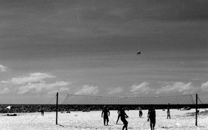 Silhouettes Playing Beach Volleyball