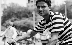 Man Wearing A Striped Shirt On The Bicycle