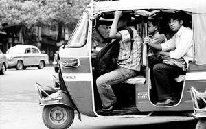 Passengers On An Auto Rickshaw