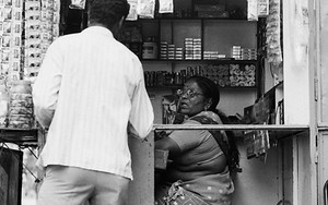 Woman And Man At A Small Shop
