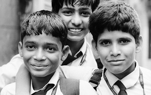 Three School Boys Wearing A Tie