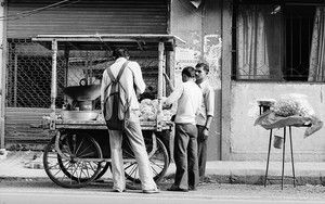 Tall Man In Food Stall