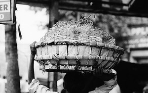 Man Carries A Big Basket