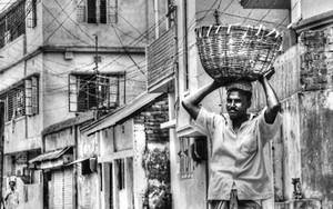 Basket On His Head And Lungi On His Waist