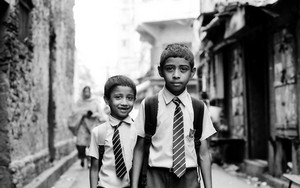 Two School Boys With A Tie