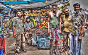 Men In Front Of A Fruit Store