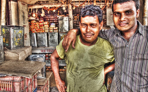 Two Men Standing Together In A Shop