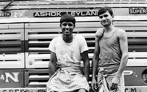 Two Men In Front Of A Truck