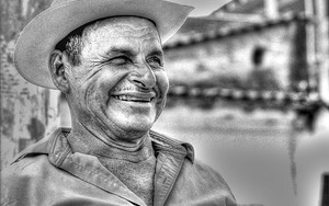 Man With A Cowboy Hat Smiles