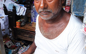 Tobacconist With Gray Hair