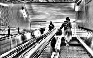 Woman On The Escalator