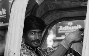 Rickshaw Wallah Relaxing On The Seat
