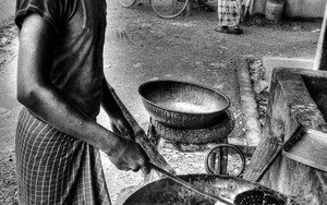 Young Man Putting On A Pot