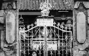Girl In Front Of A Gate