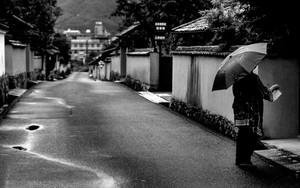 Umbrella In The Rainy Deserted Road