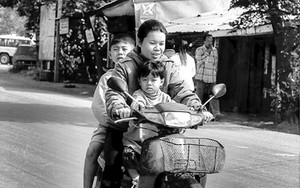 Mother And Two Sons On A Motorbike