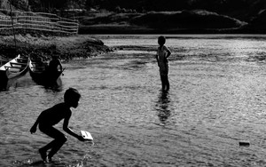 Silhouettes In Nam Khan River