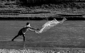 Boy Throwing A Net In Nam Khan River