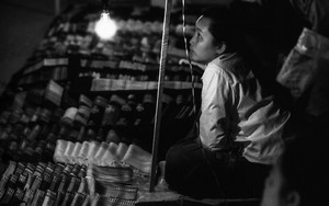 Woman Working In The Night Market