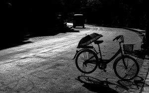 Silhouettes Of Bicycle And Umbrella