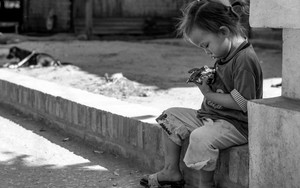 Little Child Sitting Alone By The Wayside