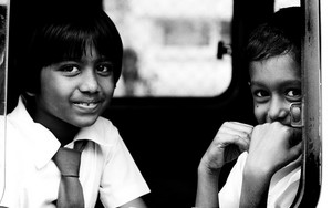 Girl And Boy By The Car Window