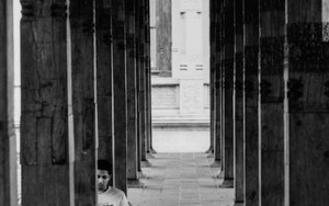 Young Man Sitting Among Columns