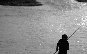 Silhouette Of A Fishing Boy