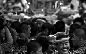 Man Smiling In The Crowd