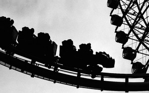 Silhouettes In An Amusement Park