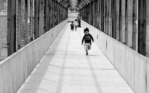 Little Boy Running The Passage