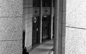 Woman Walking Between Pillars