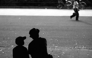 Silhouettes Sitting On The Bench