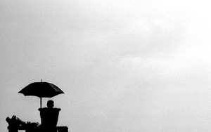 Silhouettes Of Umbrella And Bench