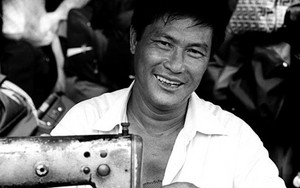 Foppish Man Beside A Sewing Machine