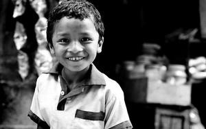 Smiling Boy Wearing A Polo Shirt