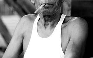 Man Smoking Cigar Called Cheroot