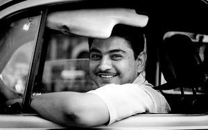 タクシー・ドライバーの微笑み