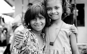 Two Smiling Girls Standing Close