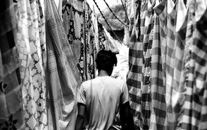 Man Walking Between Laundries