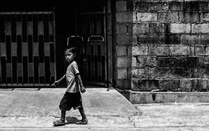 Boy Walking Under The Strong Sun