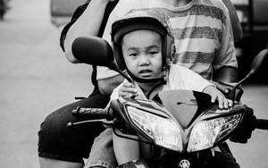 Three Helmets On A Motorbike
