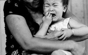 Crybaby Held By Its Grandmother