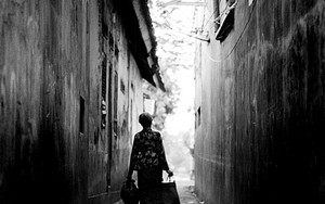 Older Woman In The Alleyway