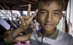 Peace Sign Of A Young Vendor
