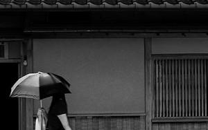 Woman Walking With A Sunshade