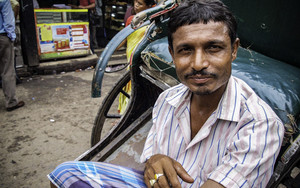 Rickshaw Wallah Wearing A Striped Shirt