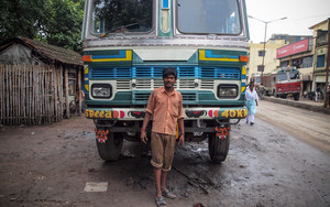 Man Standing In Front Of A Big Truck