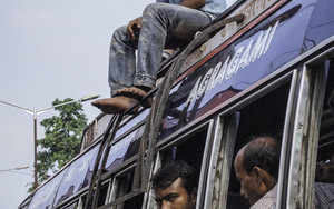 Young Man On The Roof Of A Bus