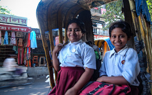 Two Girls On A Cycle Rickshaw